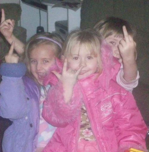 Little girls flipping gang signs finger Bad Family Portraits, Bad Family Photos, Ellen, funny family photos, worst family pics, funny pictures, awkward family photos, wtf, ugly people, stupid people, crazy people, people of walmart