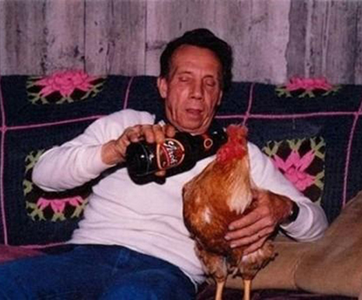Man Feeding Chicken Beer Bad Family Portraits, Bad Family Photos, Ellen, funny family photos, worst family pics, funny pictures, awkward family photos, wtf, ugly people, stupid people, crazy people, people of walmart