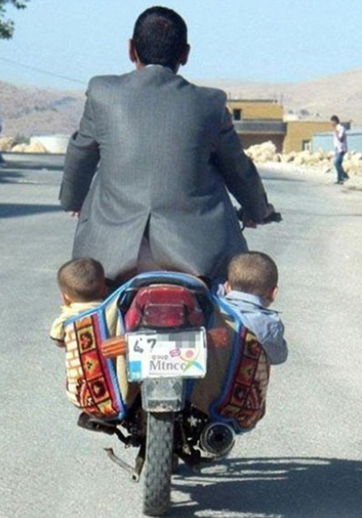 Baby Babies on Motorcycle in Saddlebags Worst Parents Bad Parents Bad Parenting Moms Dads Awkward Family Photos Stupid Parents Crazy Bad Example Terrible Horrible Awful Weird