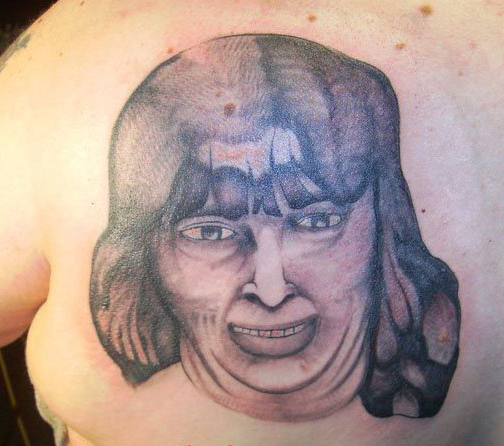 Bad Portrait of Woman Worst tattoos bad tattoos funny stupid crazy horrible regrettable wtf awkward family photos