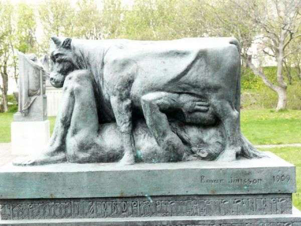 Under cow sucking udders tombstone Funny Statues Weird Statues Bizarre Sexual Strange Statues Awkward Crazy Art
