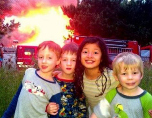 Kids posing in front of house fire - Funny Awkward Family Photos. Strange & Crazy