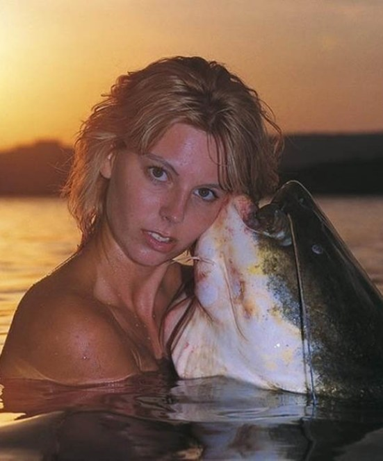 Woman Hugging Catfish ~ 34 Failed Attempts at Looking Sexy Profile Pics