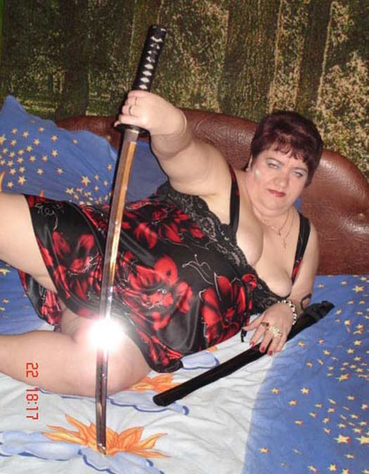 WOman with Sword – Sexy Fails Bad Glamor Shots Dating Sites Profile Pics Awkward Family Photos