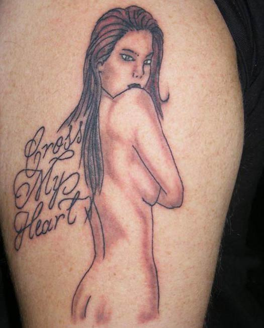 Woman Cross My Heart – The Worst Bad Tattoos, The Ugliest Regrets, too.