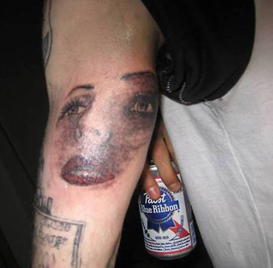 Face on Arm PBR – The Worst Bad Tattoos, The Ugliest Regrets, too.