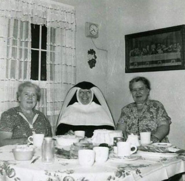 Nun with glowing eyes ~ 25 Creepy Photos