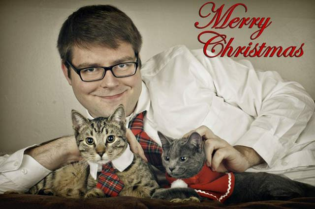 Man with Cat Card ~ 27 Funny & Creep Family Christmas Photos