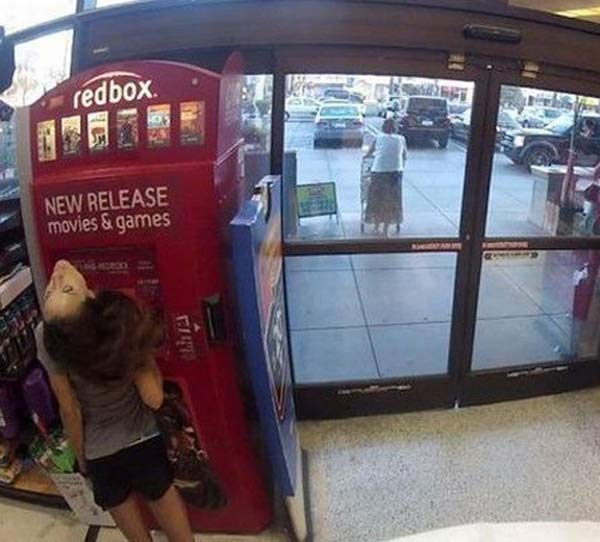 Girls Head Spinning at Redbox ~ 25 Creepy Photos
