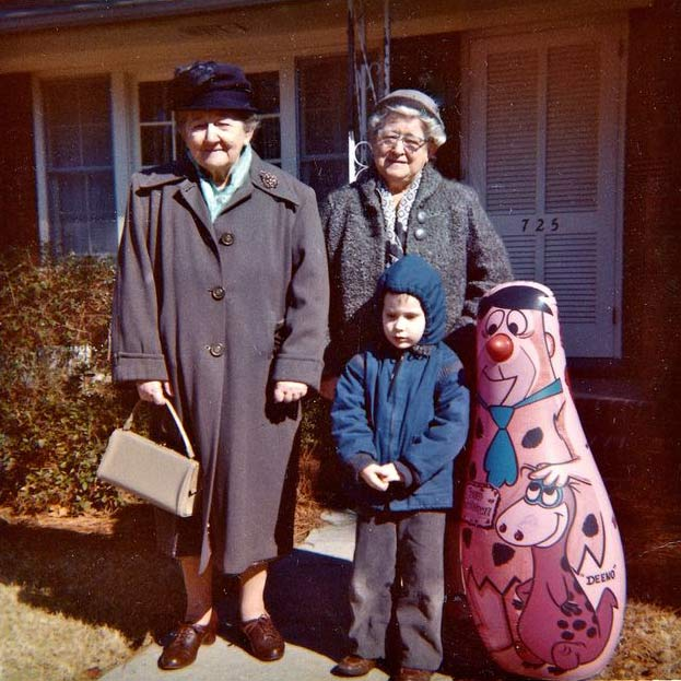 vintage color snapshot, 1950s, 60s, two grandmas, boy and fred flintstone punching bag ~ 18 Funny Awkward Family Photos