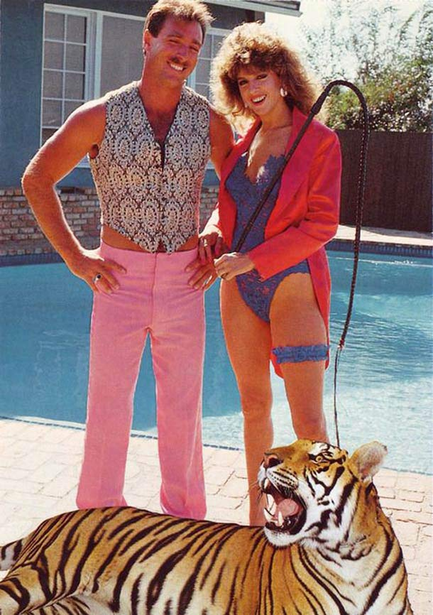 Vintage 1980s, woman in lingerie and snappy man with tiger by pool