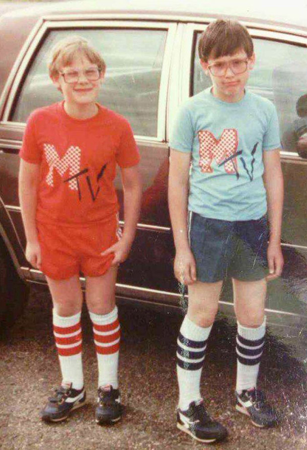Vintage 1980s snapshot. Two nerdy boys in Mtv shirts and high white tube socks