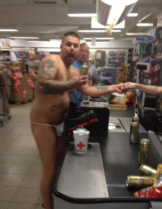 Man with tattoos in thong at store check out, lost a bet ~ The worst bad tattoos fails