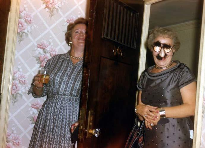 vintage-color-snapshot-grandma-hising-behind-door-groucho-glasses