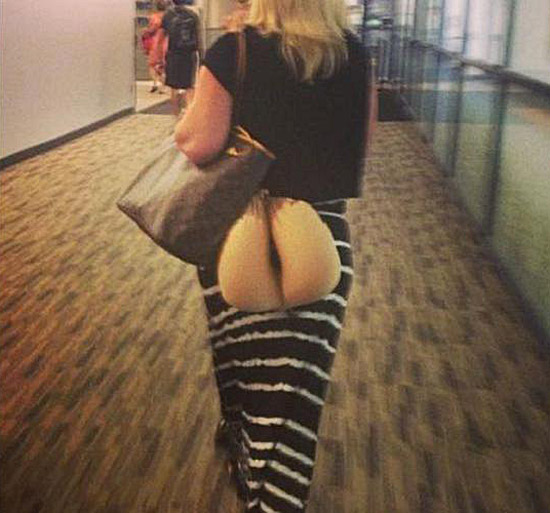 Woman carrying a travel pillow that looks like her bare ass butt ~ You have such a dirty mind