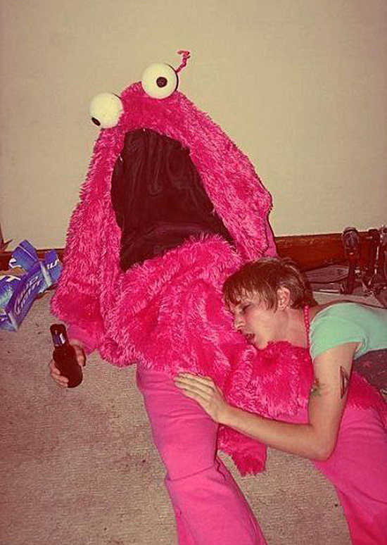 Vintage Snap: Woman passed out drunk with man in fuzzy pink monster suit