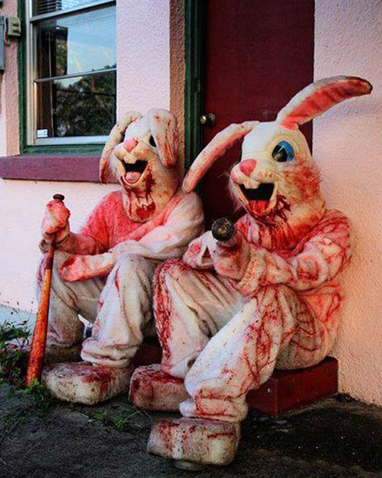 2 people in bloody easter bunny costumes holding bloody bats, creepy!