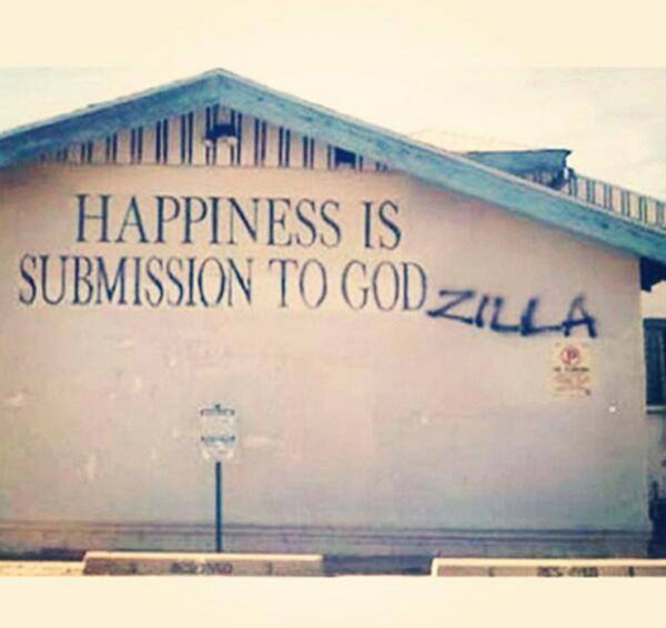 Curch graffitti: Happiness is submission to Godzilla
