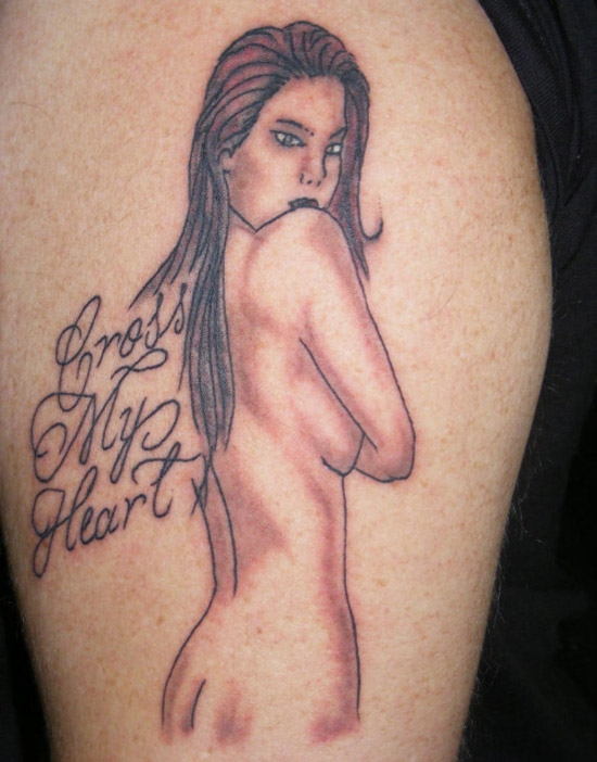 Naked woman pin up and cross my heart tattoo