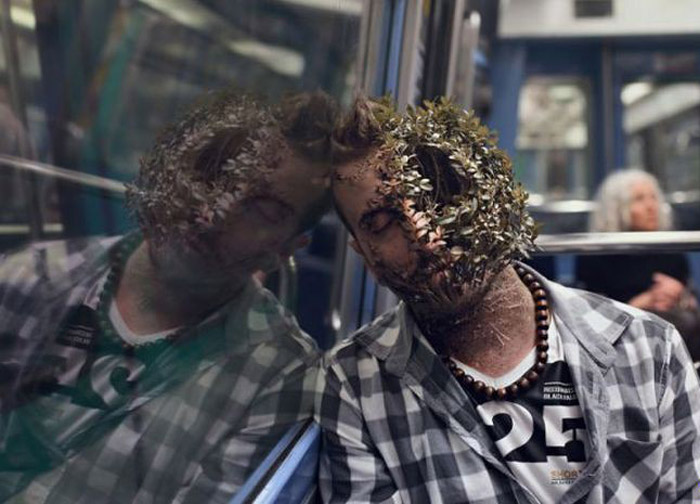 Creepy pic of man sleeping on bus with plants growing from his face