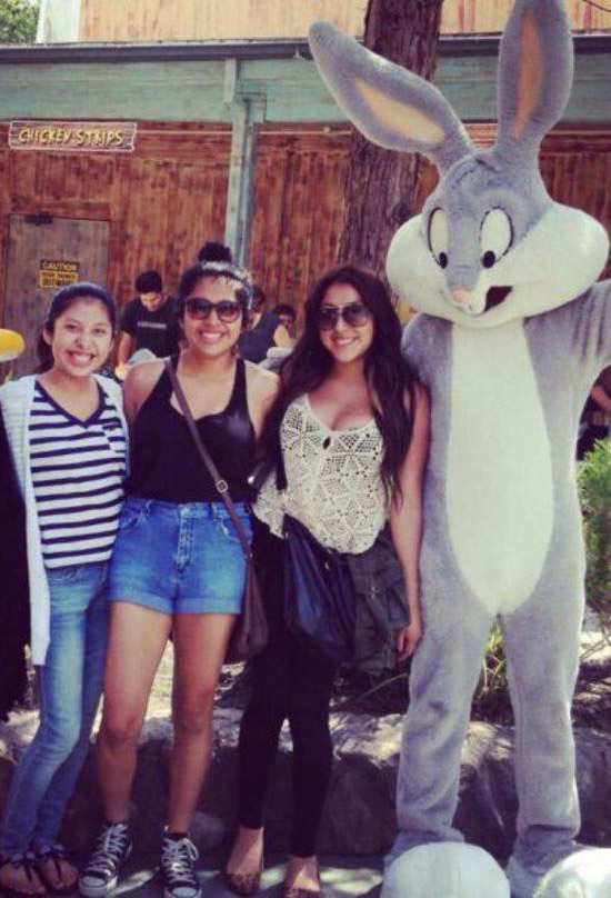 Family portrait at Six Flags Amusement Park with Bugs Bunny checking out girl's boobs ~ Awkwardly Funny Family Photos