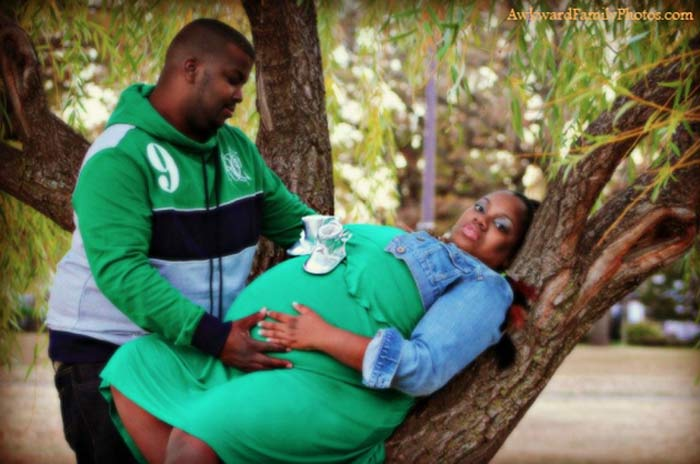 Funny Bad Pregnancy Photos ~ hugely pregnant woman lying in tree