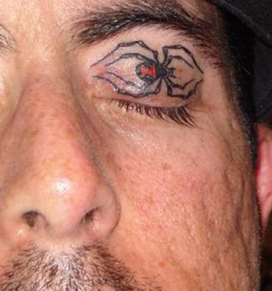 Spider on eyelid ~ The ugliest worst bad tattoos