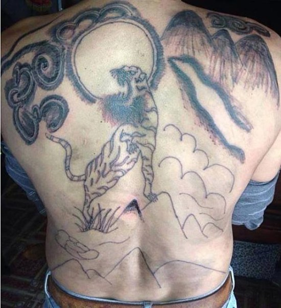 Bad Tiger tattoo on back_ bearded hipster tiger ~ the ugliest bad worst tattoos