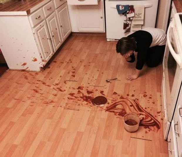 woman on kitchen floor crying after bowl of pudding dropped and spilled
