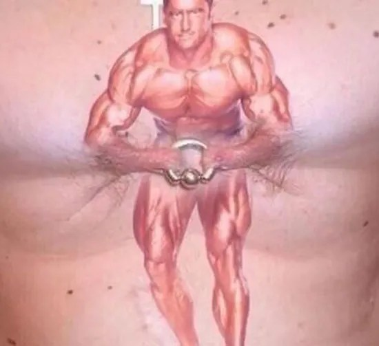body builder chest piece pulling together nipple rings Best worst nipple tattoos