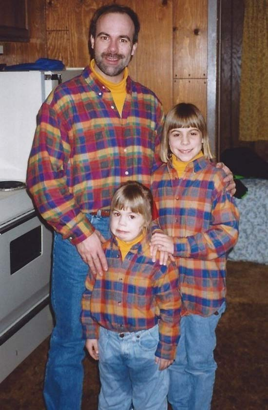 Classic Family Photo from 1970 with dad and daughters in matching plaid flannel shirts. Youngest girl with pee pee pants