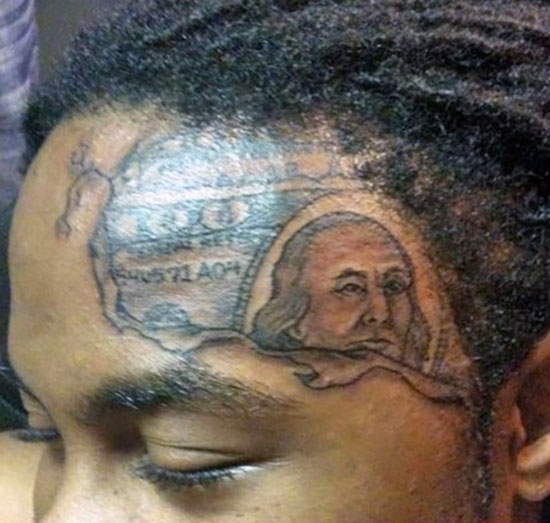 Hundred dollar bill on forehead ~The Ugliest Worst Bad Tattoos