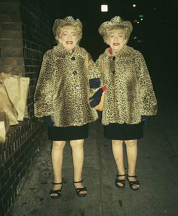 Classic vintage snap of identical twin grandmas in leopard print jackets and hats