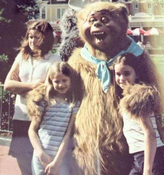 vintage pic, girls with bear at amusement park, pouting ~Funny Awkward Family Photos