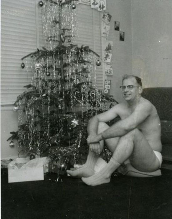 26 Funny Awkward Christmas Photos ~ Vintage snap, dad in underwear sitting in front of tree