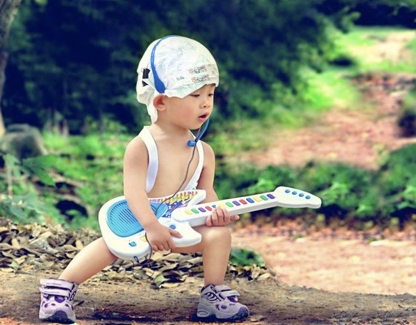 Funny Awkward Family Photos: cool bad ass baby playing guitar with diaper on his head