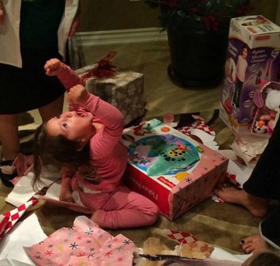 26 Funny Awkward Christmas Family Photos~ Excited kid, she got what she wanted