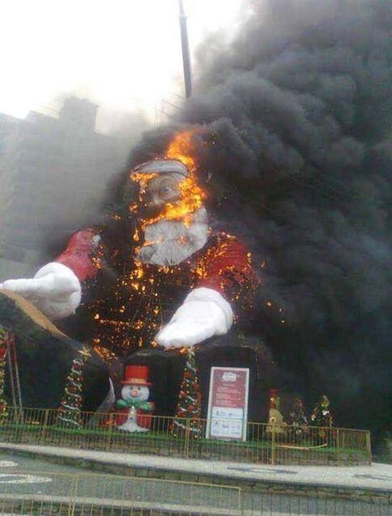 Funny awkward Christmas pis ~ Giant inflatable Santa burning on fire