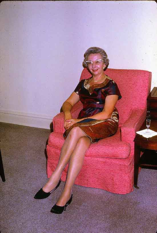 Funny Awkward Family Photos: Vintage color snapshot of grandma in pink chair, early 1960s