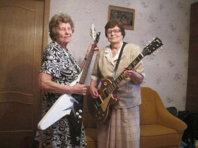 Two grandmas with electric guitars, old ladies