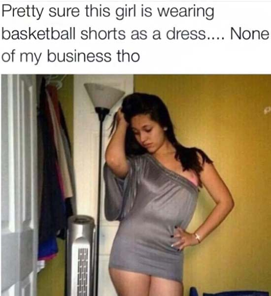 Funny Pictures: oman wearing basketball shorts as dress