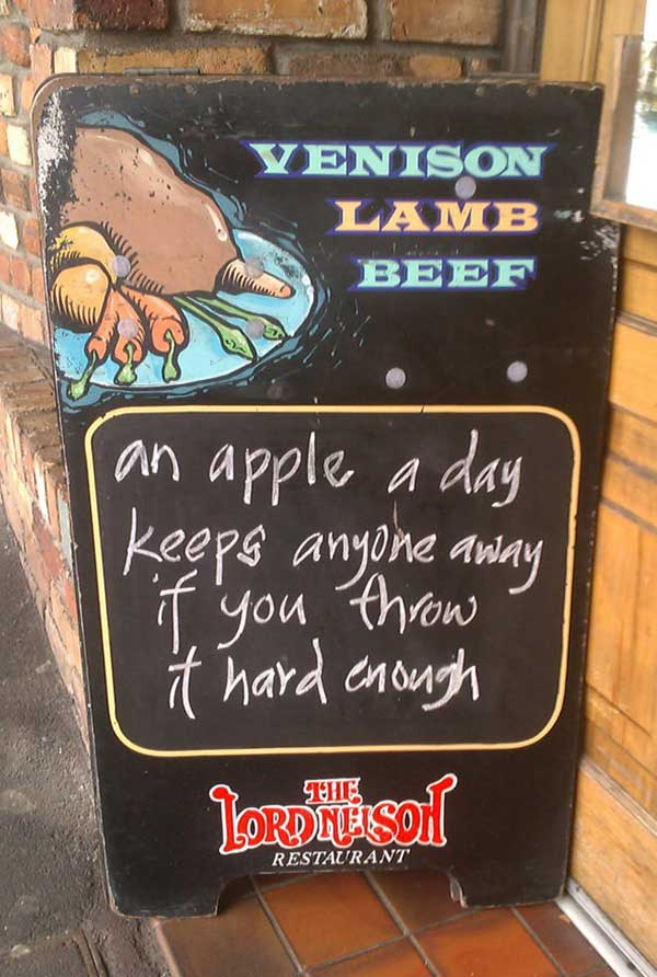 Funny sidewalk chalkboard signs: An apple a day keeps anyone away if you throw it hard enough