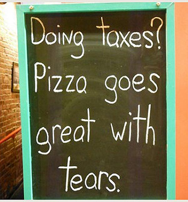 Funny sidewalk chalkboard signs: doing taxes? pizza goes great with tears
