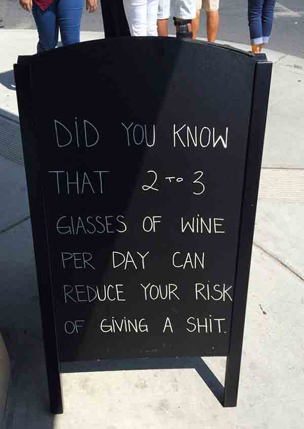Funny sidewalk chalkboard signs: did you know 2 to 3 glasses of wine per day can reduce your risk of giving a shit
