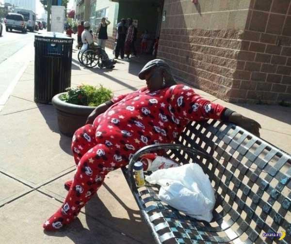 awkward family photo man in mickey mouse pajamas sleeping at bus stop bench