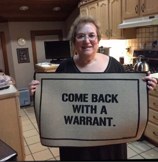 awkward family mom with come back with a warrant welcome mat