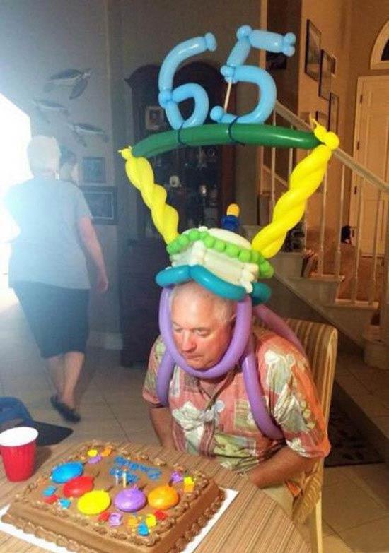 awkward family 65th birthday party balloons