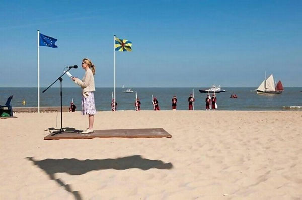 perfectly timed photos ~ woman on beach giving speech floating in air
