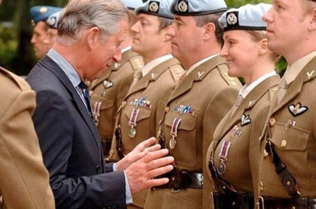 perfectly timed photos ~ prince charles checking out woman soldier's boobs