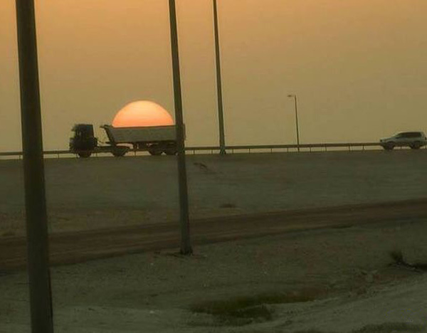 perfectly-timed-sunset-dumptruck